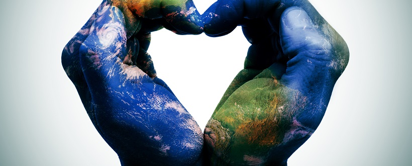 a world map in man hands forming a heart (Earth map furnished by